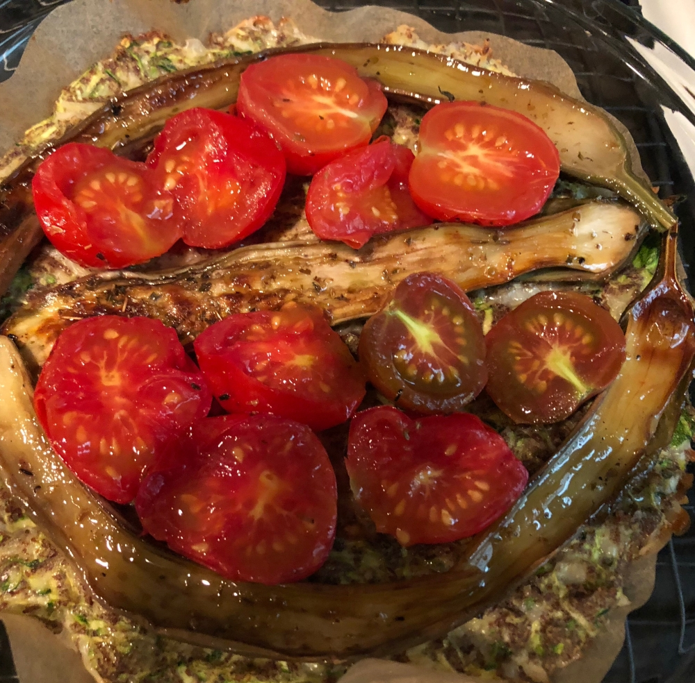 tomatoes and eggplant on top of zucchini crust
