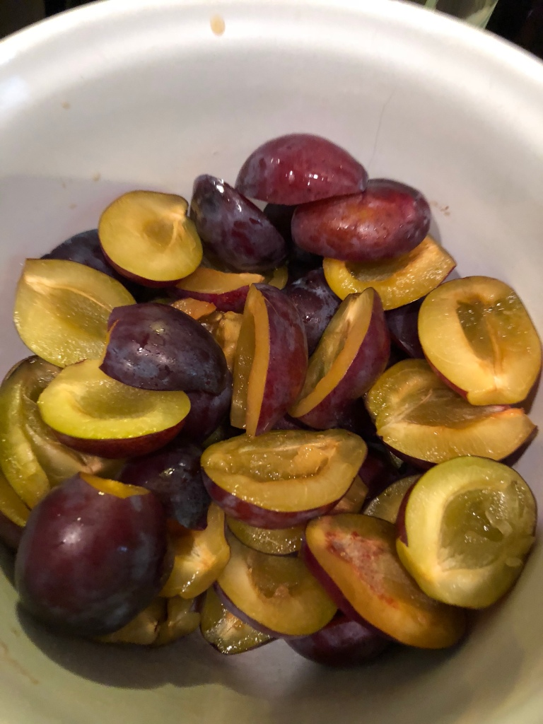 Pitted italian plums in a bowl